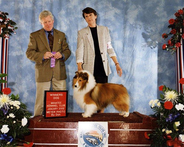 Ricky receiving Winners Dog.